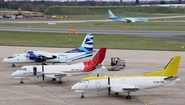 Vulkan Air Antonov AN26 freighter EW-378TG @BHX with 2 SAAB 340`s of Fleet Air