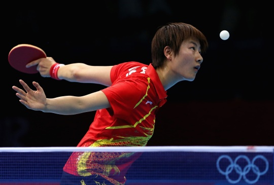 Ning Ding of China in action in the women's team table tennis day 10.