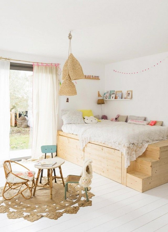 Kids bohemian inspired bedroom with a vintage tea set and a wicker pendant light