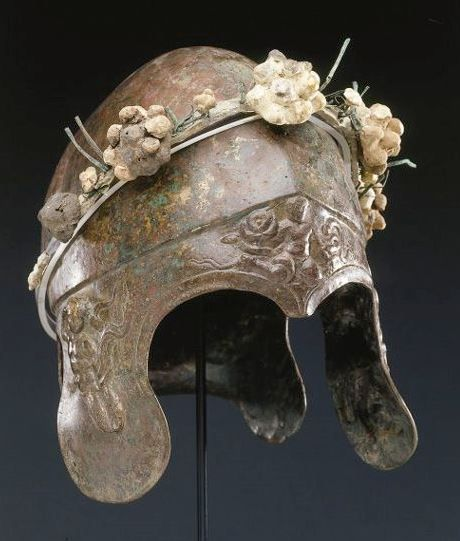 Chalcidian helmet, 4th century B.C. Of hammered sheet, with a rounded bowl off-set from the neck- and cheek-guards and the brim by a ridge, the neck-guard flaring along the back edge, the forward elements adorned with relief ornament illustrating the Herakles cycle, 26 cm high Private collection, from Christie's auction