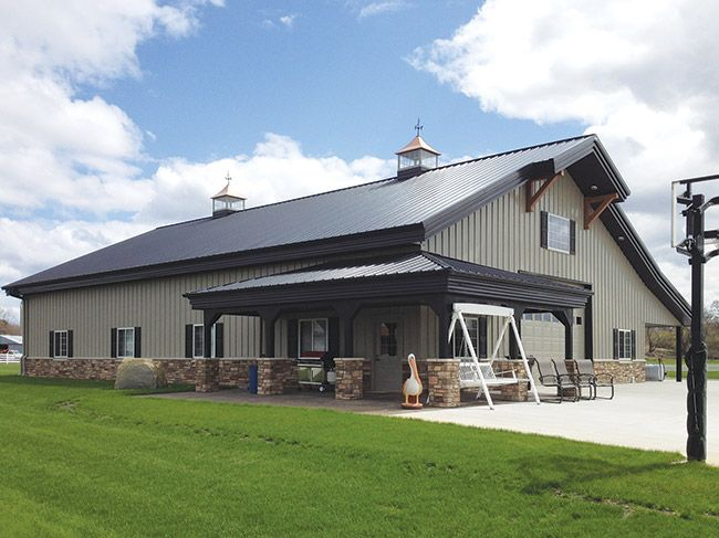 Rock wainscoting on metal building with gable arch for Metal pole barn homes plans