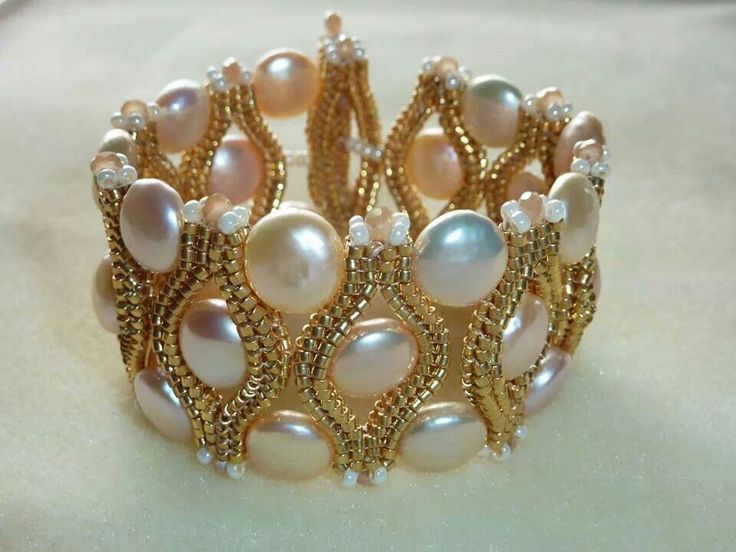 Bracelet..  I like this design, but would replace the white seed beads with crystals.