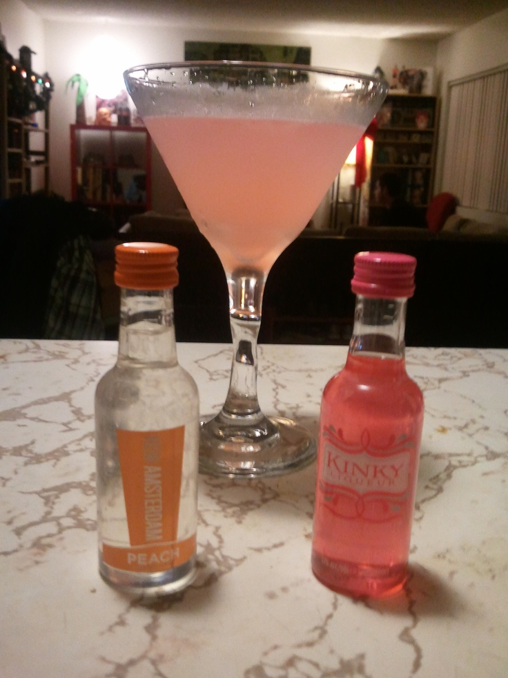 """Kink Out With Your Peach Out"" (Original Drink Recipe by Diana) 2 oz Kinky Liqueur, 2 oz New Amsterdam Peach Vodka, 1/2 oz Triple Sec, 1/4 oz lime juice. Shake all ingredients with ice in a cocktail shaker. Pour into chilled martini glass and enjoy! Yummy"