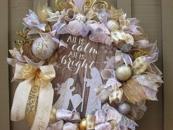 All is Calm All is Bright - the beautiful, quiet, peaceful words welcoming the birth of Christ - such a perfect way to celebrate Christmas! Invoke the true meaning of Christmas by displaying this wreath in your home. This wreath is made using a base of burlap deco mesh with burlap and white burlap ruffles throughout the wreath. The wreath is accented with premium wired ribbons in colors of sheer white, decorative sparkling white, mocha with decorative swirls,3 gold sparkling, a cream with…