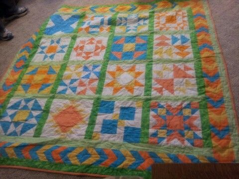 Bright colored traditional block quilt.  Training Wheels  These are the blocks my teacher (Linda Bay) had me start with.  She is the best teacher ever!