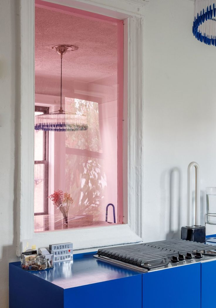 Pink plexiglass window in the kitchen of architect and designer Harry Nuriev's Brooklyn apartment in NY