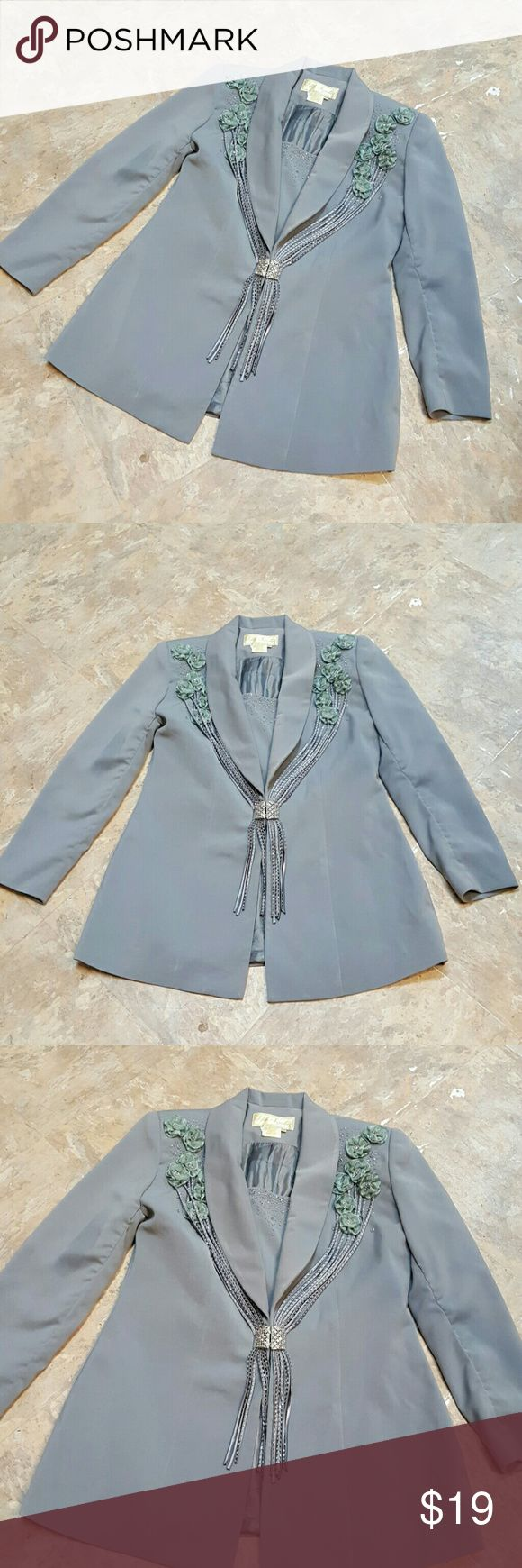 Vintage Fifth Sunday Exclusive Jacket Size 12 What a beautiful piece.  Lots of beautiful beads adorn the jacket as well as a beautiful silver clasp with clear rhinestones.   Flowers from fabric also adore the front.  In great condition with no stains, tares or missing beads.  The color is a beautiful gray/blue color.  The first few pictures are the true color.   Feel free to ask any questions before purchasing.   Thanks for shopping my closet! Fifth Sunday Jackets & Coats