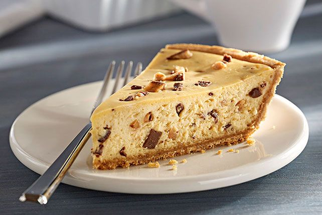 A ready-to-use graham cracker crumb crust and chopped chocolate-covered English toffee bars help keep the prep time for this cheesecake to just 10 minutes.