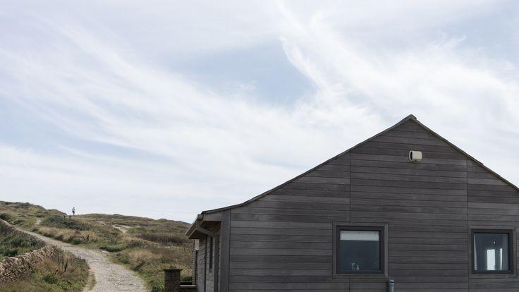 Grey wood house at Golden Cap, Dorset, England