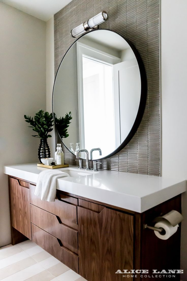 A contemporary vanity and a unique application of textured tile in a contemporary bathroom. Glass House  designed by Alice Lane | Photographed by Lindsay Salazzar