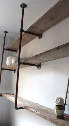 I like how this is rustic and industrial at the same time pipe and board shelving