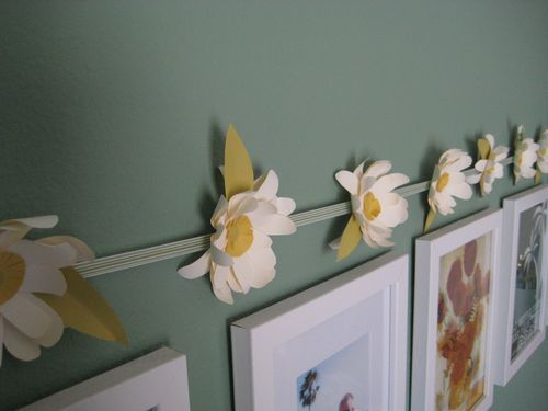 Paper flowers... I'm thinking with a map of course http://eliseblaha.typepad.com/golden/get-crafty/page/9/