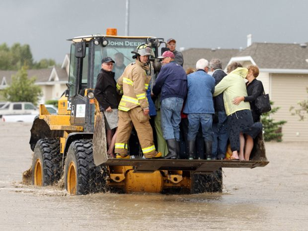 A front end loader was being used to rescue people from the rising flood waters of the Highwood River in High River, Alberta on June 20, 2013.