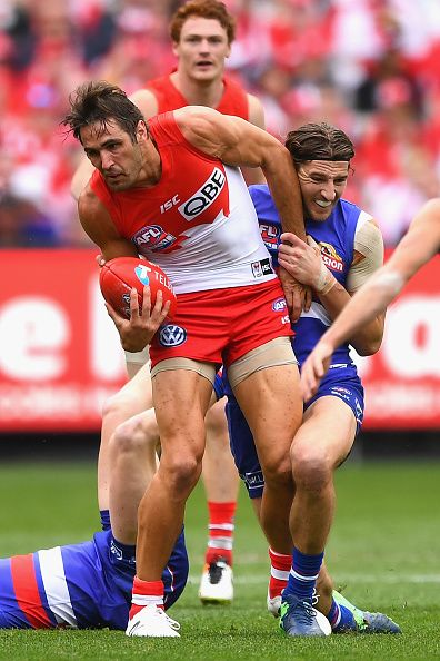 #AFLGF2016 Josh Kennedy of the Swans is tackled by Marcus Bontempelli of the Bulldogs during the 2016 AFL Grand Final match between the Sydney Swans and the...