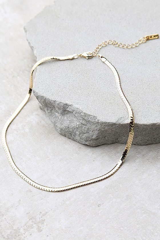 """Trust us when we say that the Just Believe Gold Chain Choker Necklace will bring a little magic to all of your outfits! A thin, slinky gold snake chain is formed to a stylish choker necklace. Necklace measures 12.5"""" around with a 2"""" extender chain."""
