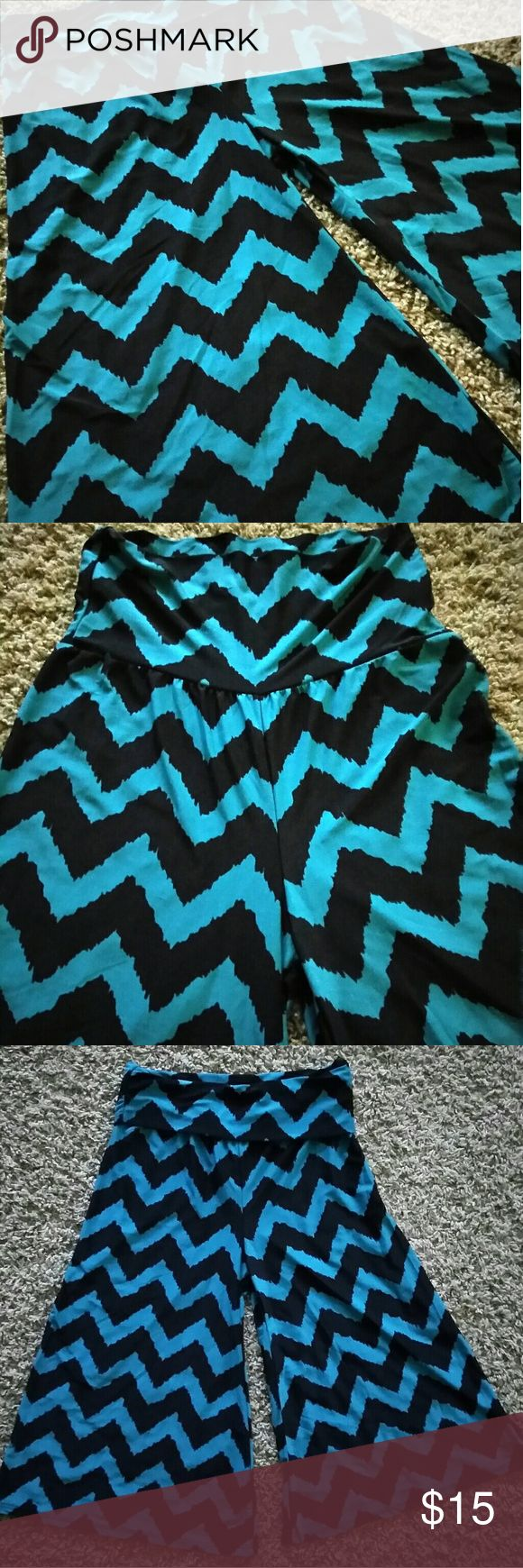 Stylish Palazzo Style Bermudas Black and teal Silky and stretchy material Yoga like waist band that folds over So, so comfortable and perfect for summer or thrown over a bathing suit for the beach! boutique Shorts Bermudas