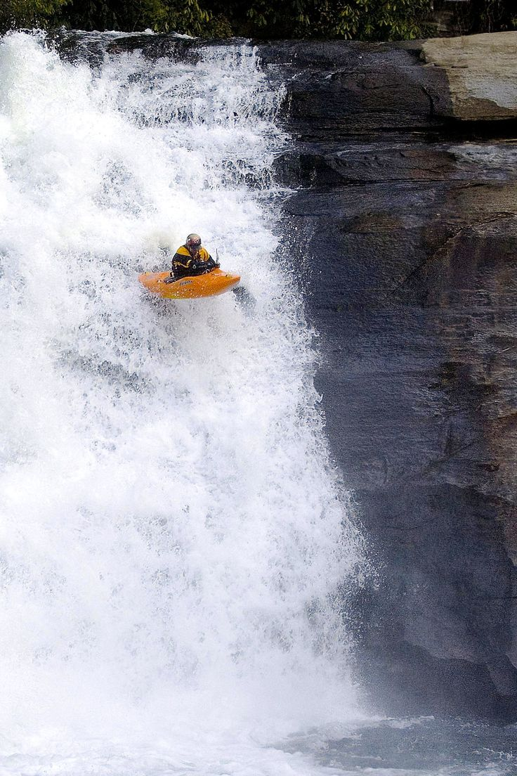 Kayak Going Over Triple Falls located in Dupont State Forest(Transylvania County,NC.)