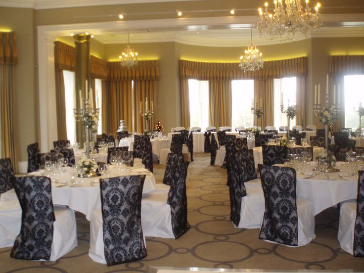 Black flocked organza chair veils on white chair covers at Rudding Park