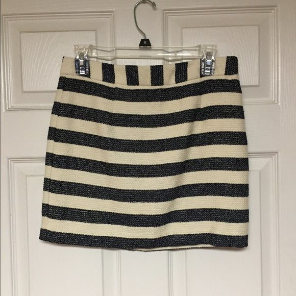 White and Navy Striped Skirt Forever 21 Contemporary off white and navy blue stripes skirt! Never worn and fits true to size! Forever 21 Skirts Mini
