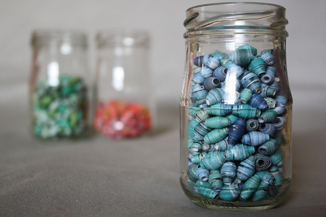 DIY: Paper Beads - under style as another suggestion for filling up old glass jars/vases for display.