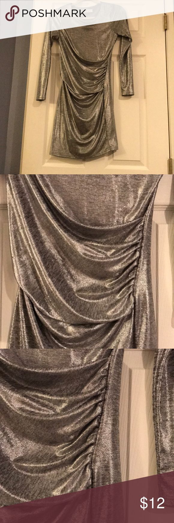 Metallic Dress Shine On Silver Bodycon Dress from Tobi. Purchased for a Halloween costume. Will most likely never wear again.   Size: Small Length: 33in Lined  Polyester and spandex Tobi Dresses Mini