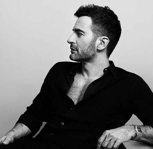 """Marc Jacobs (born April 9, 1963) is an American fashion designer. He is the head designer for Marc Jacobs, as well as Marc by Marc Jacobs, a diffusion line, with more than 200 retail stores in 80 countries. He has been the creative director of the French design house Louis Vuitton since 1997. Jacobs is on Time Magazine's """"2010 Time 100"""" list of the 100 most influential people in the world, and ranked 12th on Out Magazine's 2011 list of """"50 Most Powerful Gay Men and Women in America""""."""