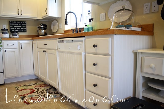 Adding beadboard panel to dishwasher door = cute diy!