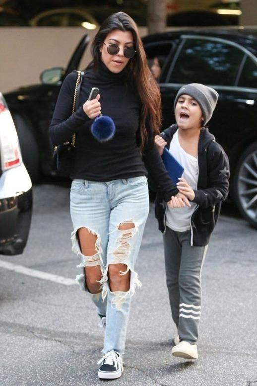 Kourtney Kardashian wearing Fendi Pompom Keychain, Vans Old Skool Sneakers and Gucci Marmont Bag