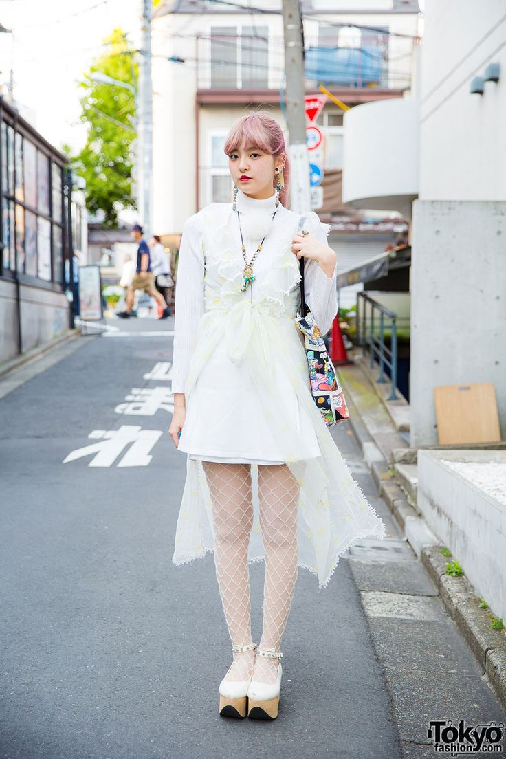 tokyo-fashion: Misa on the street in Harajuku wearing vintage lingerie over sweater and skirt from Nadia Harajuku fishnets rocking horse shoes and a comic print tote bag from Eat Me. Full Look