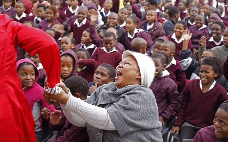 A teacher reacts at a school as they celebrate former South African President Nelson Mandela's birthday in Cape Town,