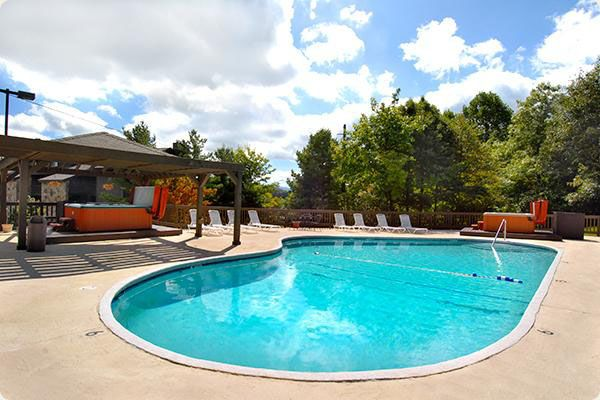 A sparkling blue swimming pool at Amazing Views Cabin Rentals