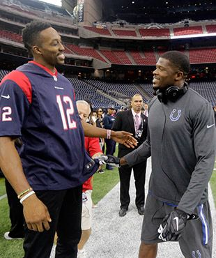 Rockets center Dwight Howard greets Indianapolis Colts  WR Andre Johnson  before Texans & Colts game in NRG Stadium