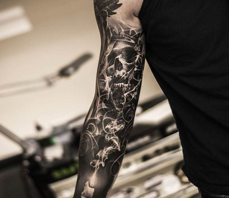Black and grey sleeve tattoo by Oscar Akermo
