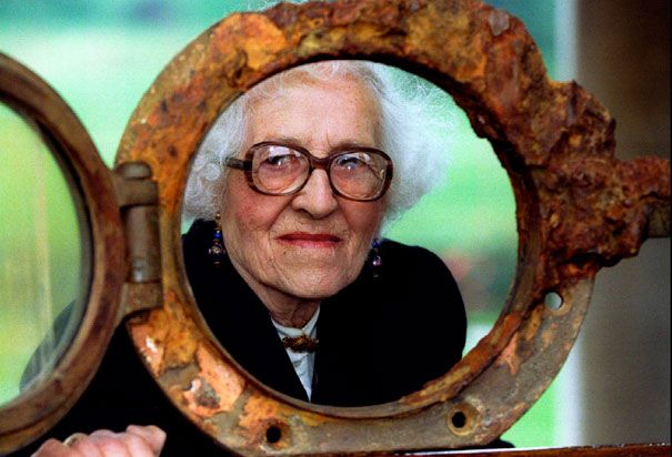 Millvina Dean: Millvina Dean (1912-2009, staring through an original Titanic porthole) was only a few months old when she boarded the Titanic with her family. She was the youngest survivor of the wreck. (photographed in 1994)