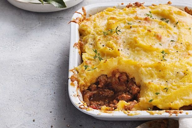 Make the casserole for this pie in advance, then pop it in the fridge or freezer. Then just reheat it, add the polenta topping and bake!