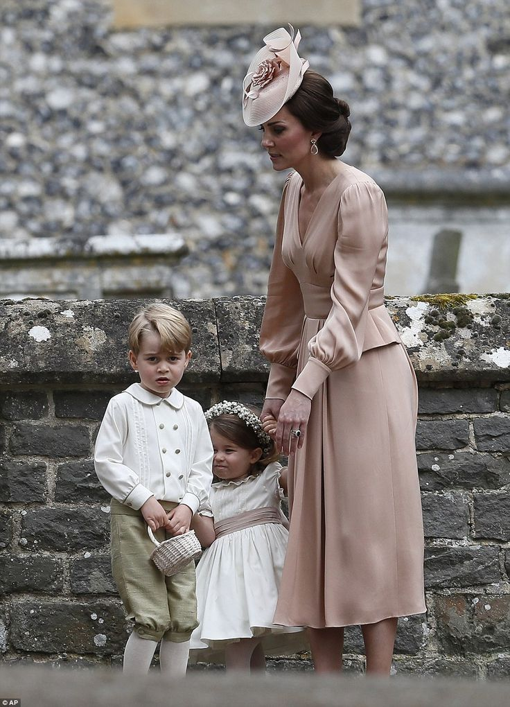 Kate stands with Princess Charlotte and Prince George, who were flower boys and girls at the wedding of Pippa Middleton and James Matthews, as she waits for her husband, Prince William