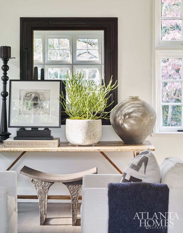 A Rustic Chic Focal Point In The Living Room Includes An Antique Trestle Table