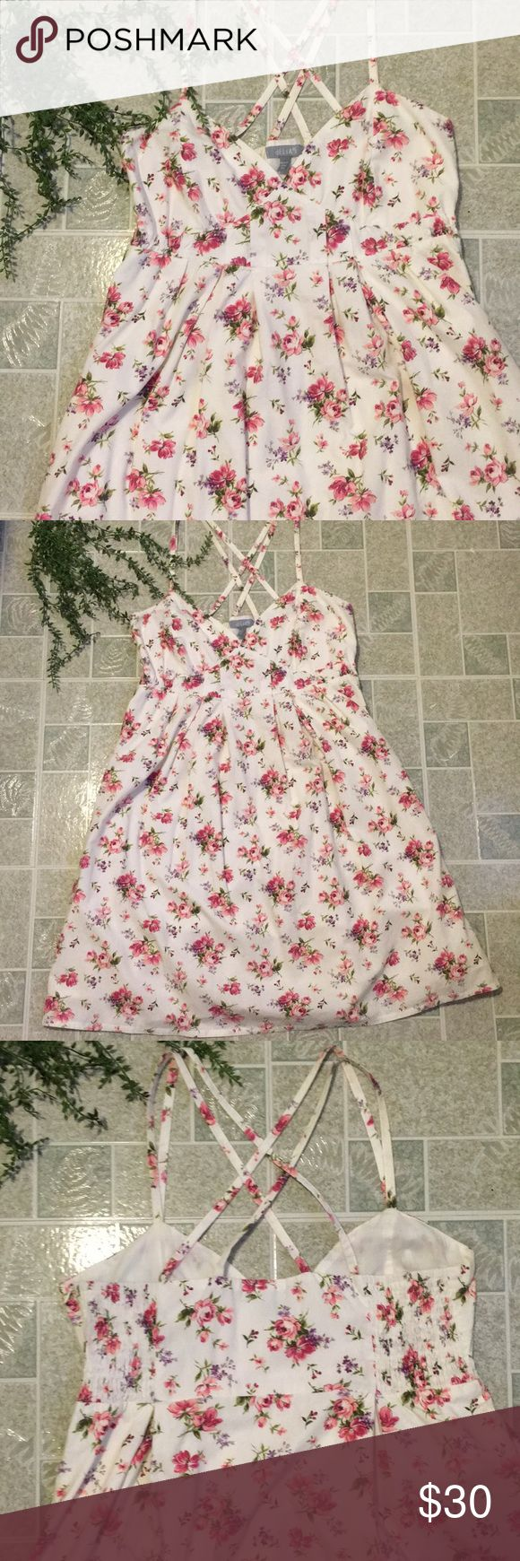 Beautiful Delia's Cotton Garden Party Dress Absolutely stunning floral print cotton dress. The back is smocked, and it has a full flowy skirt. Perfect condition. Probably will work best for someone who isn't over a C cup. delias Dresses Midi
