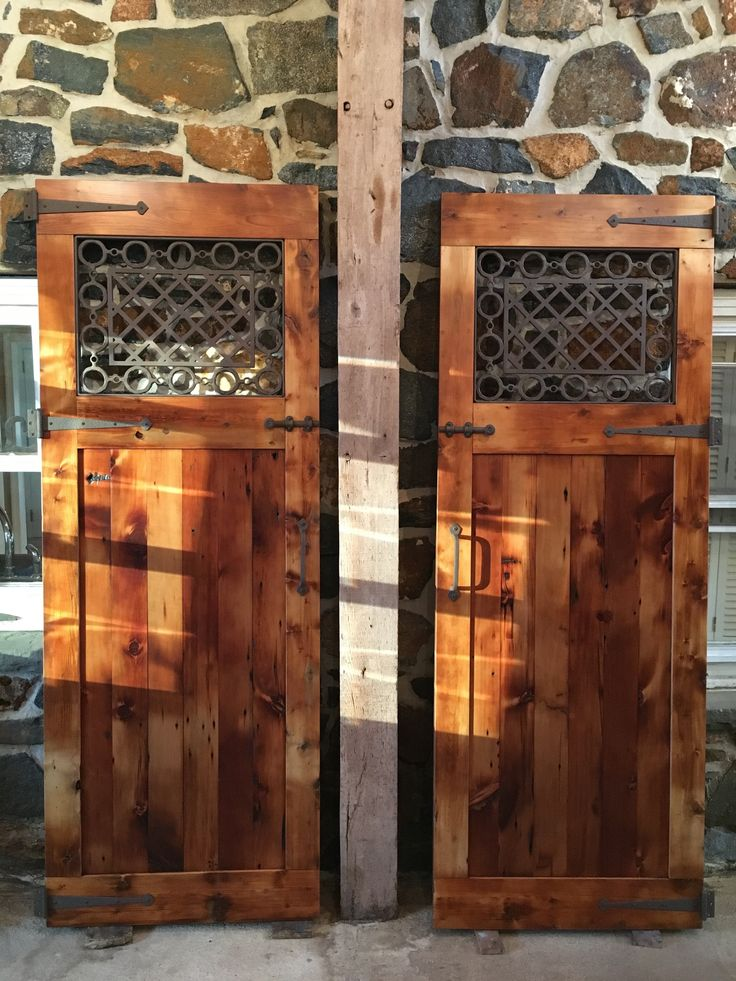 Reclaimed Barn Wood Barn Doors With Custom Hand Forged Iron Windows