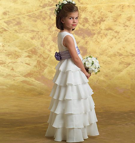 B4967 - Beautiful! I think this is the one, but what do you think? It's simple and elegant. It would look great on a tall toddler girl, and I know I could find a sleeve pattern that would be perfect.     It would be fun to make a matching big sister dress, maybe with three or four tiers, in a pale color or pastel print.    But, hey, I just started looking again. There may be more.