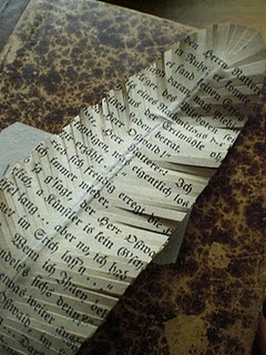 This would make a great bookmark! DIY book page imprint on feather.