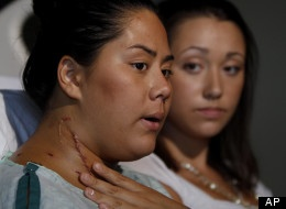 Best friends Allie Young, left, 19 and Stephanie Davies, 21, sit in a room at the University of Colorado Hospital in Aurora, Colo., Monday July 23, 2012, and recount the story of how Stephanie saved Allie's life during the mass theater shooting in Aurora by applying pressure to a gushing neck wound and helping her to safety July 20, 2012.