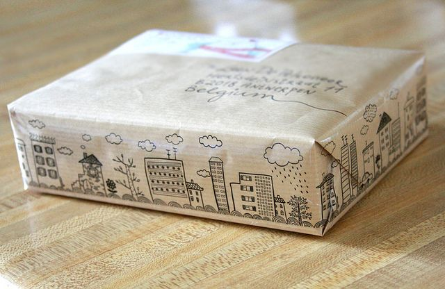 Fun touch for mailing a package! Doodle on brown paper to add a fun surprise to the package.