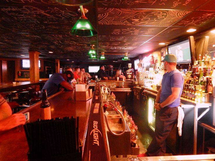 Rib Cage bartender Simon Strickland tells a joke to former