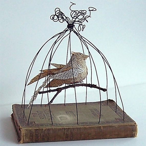 Love this birdcage made from an old book