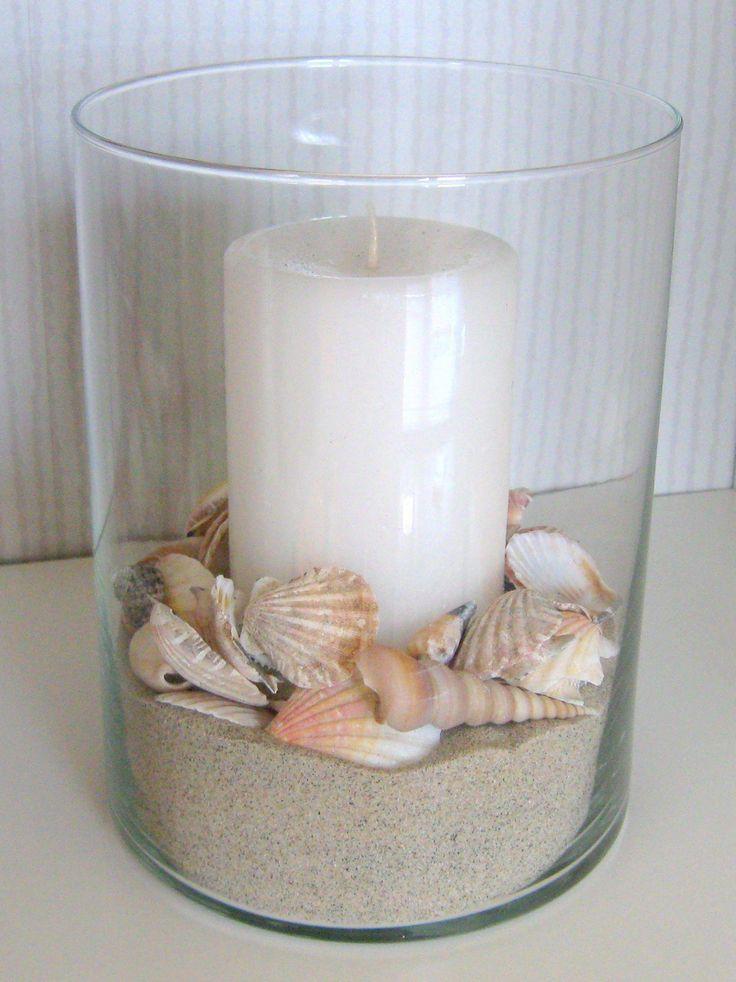 DIY decor for our beach home. Hurricane lamp bought at Walmart, shells bought at The Dollar Tree and sand from the beach – viola!