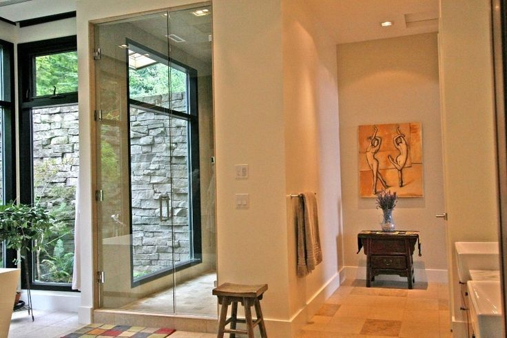 Steam Shower, enclosed toilet, tub ... install big sliding glass doors & windows that lead to outside but is encased in a stone wall and have outdoor oasis/shower (tropical planting, bamboo, slate tiles, tall walls...)
