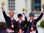 Carl Hester, Laura Bechtolsheimer and Charlotte Dujardin of Great Britain celebrate