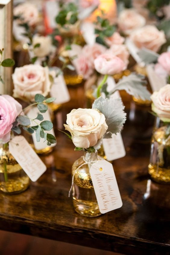 bottled roses make for not only a creative escort card / http://www.himisspuff.com/creative-seating-cards-and-displays/5/