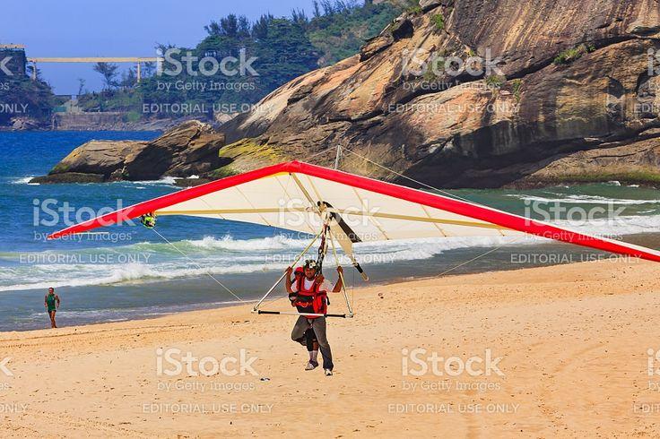 Rio de Janeiro, Brazil: Hang Glider landing on Sao Conrado royalty-free stock photo